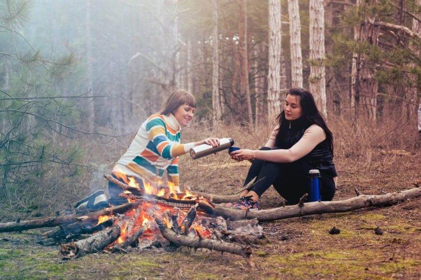 camping women fire